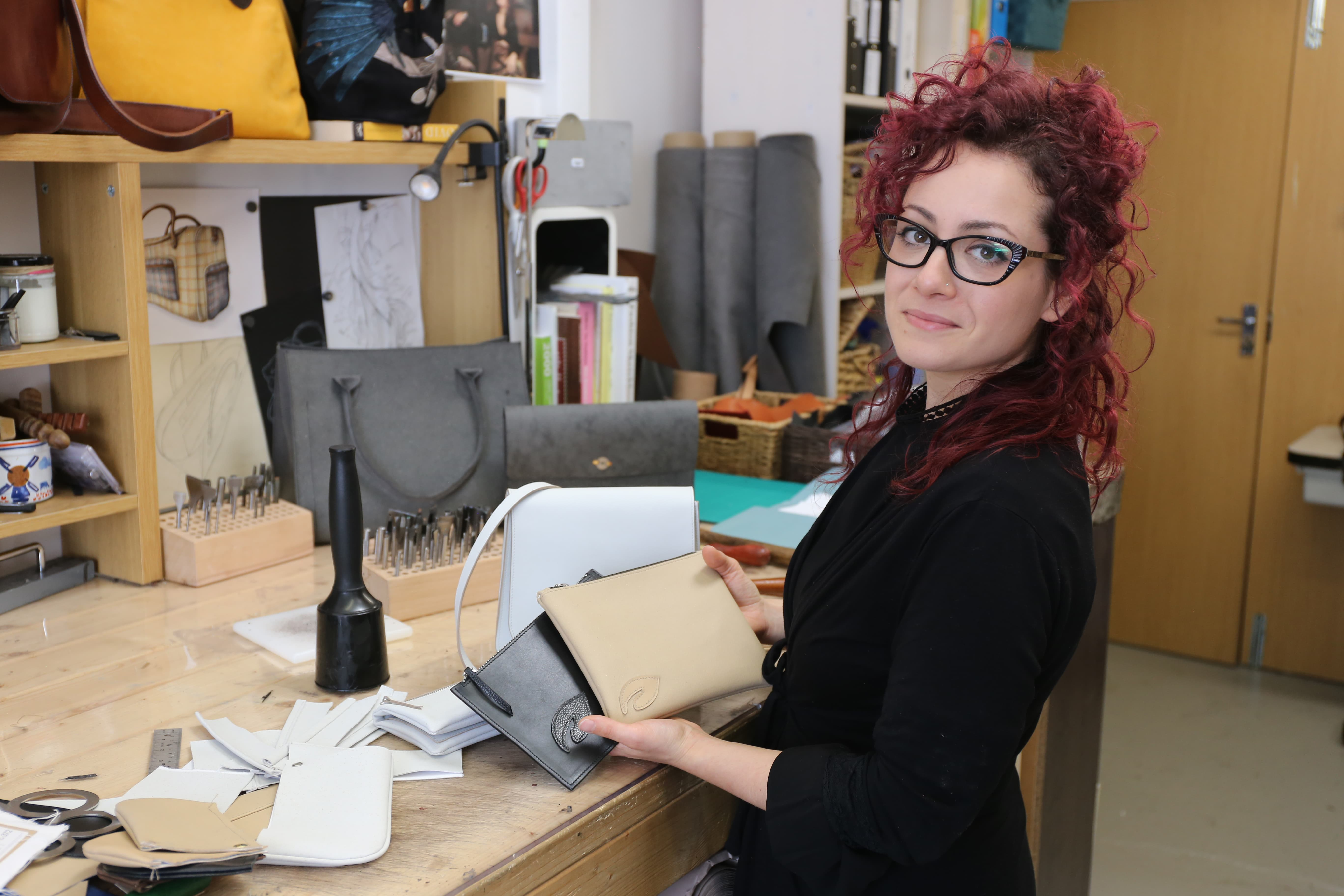 Sara Battiston, founder of the London Leather Workshop, displays accessories made with MIRUM.